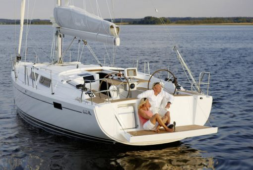 Couple sitting on the edge of the boat floating a the sea